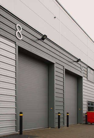 warehouse building: Drive in Doors x2 Stock Photo