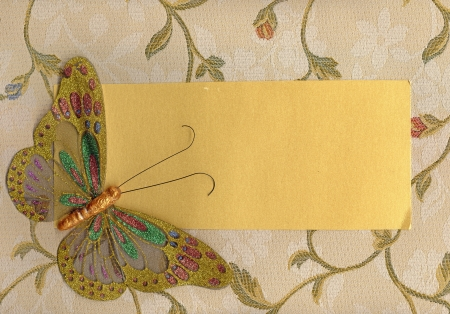 artificial flowers: Beautiful butterfly made in fabric on texture background