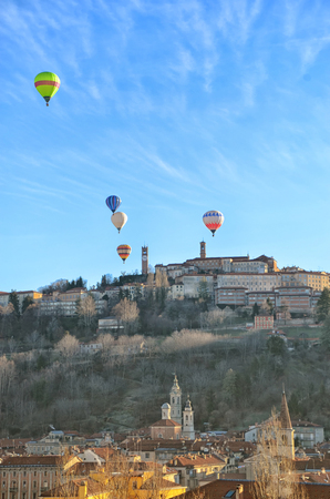 Five Hot Air Balloons over an Italian Village photo
