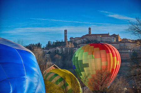 Inflating Hot Air Balloons in Italian Village