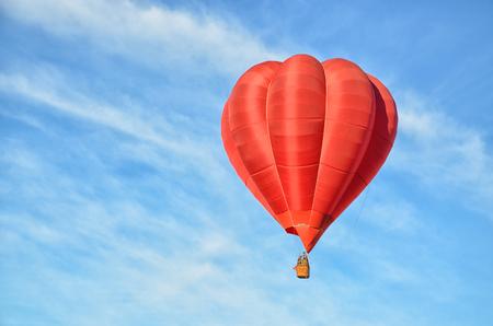 Red Hot Air Balloon in the air photo