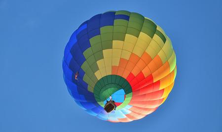 hot air ballon: Multicolored and Striped Hot Air Balloon Stock Photo