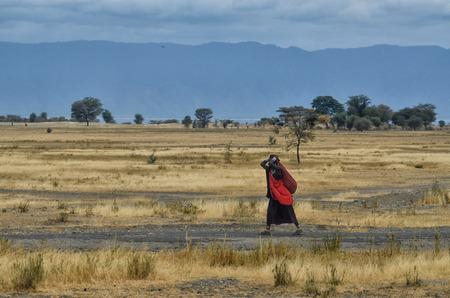 Masai woman in African Landscape