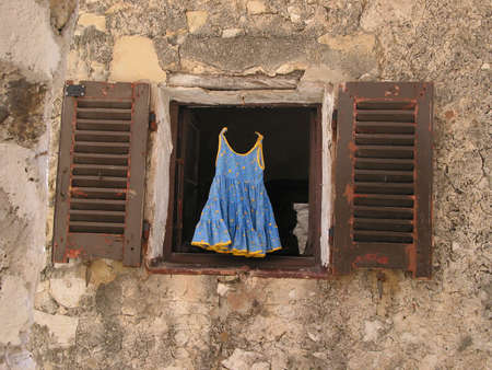 dilapidation: Childs dress for sale Stock Photo