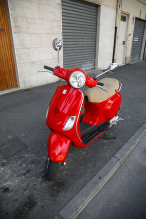 Red Italian scooter.
