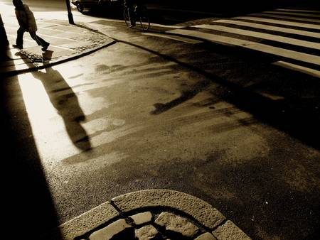 Urban capture with low winter sun after rain. Stock Photo