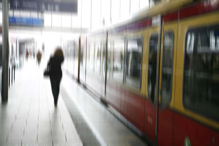 Stressed female taking the S-train - Berlin, Germany. Motion blur.