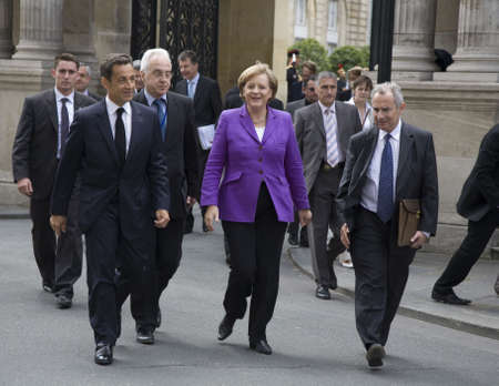 PARIS, FRANCE - JUNE 11 - 2009: French president Nicolas Sarkozy (front left) and German chancellor Angela Merkel  (front middle) outside the Elysee Palace on their way to lunch.