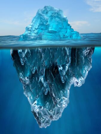 Iceberg floating in the ocean, both the tip and the submerged parts are visible. Top part is smaller than bottom.