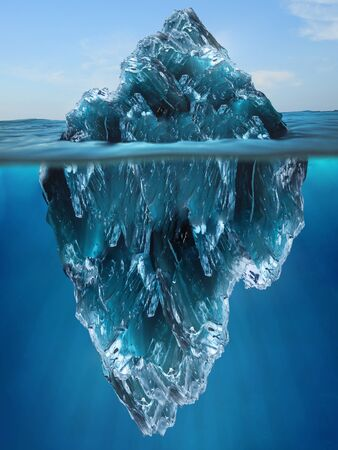 Tip of an Iceberg floating in the water Stock Photo