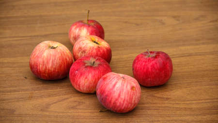 red apples: Autumn. Red apples fall to the ground.