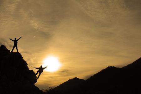 日の出ロック クライミング 写真素材