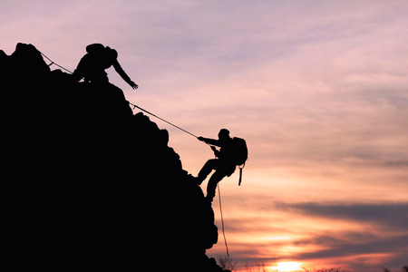man climbing: rock climbing and help