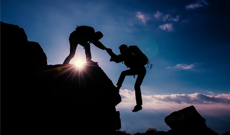 mountaineer helpingclimbing help Archivio Fotografico