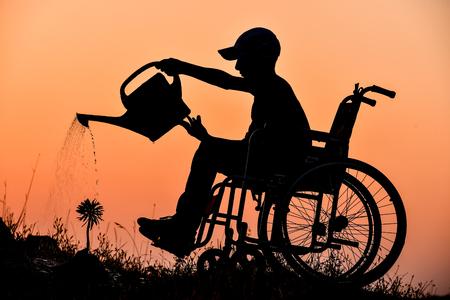 De gehandicapte jonge en liefde van bloemen Stockfoto