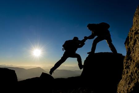 山の頂上での協力 写真素材