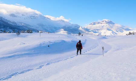 glory of the snow: hiking in snowy mountains Stock Photo