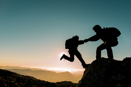 trust people: peak climbing assistance and support Stock Photo