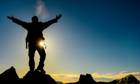 risk taking: peace and success of the summit of the mountain Stock Photo