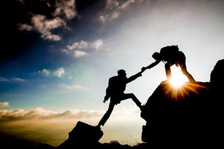 rock climbing silhouette Standard-Bild