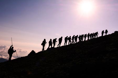 team climbing the mountain Archivio Fotografico