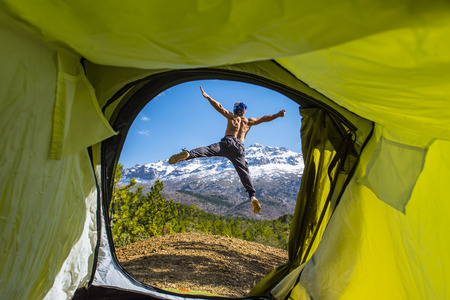 winning mood: camping tent and happy climber