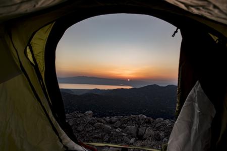 winning mood: tent to watch the sunrise Stock Photo