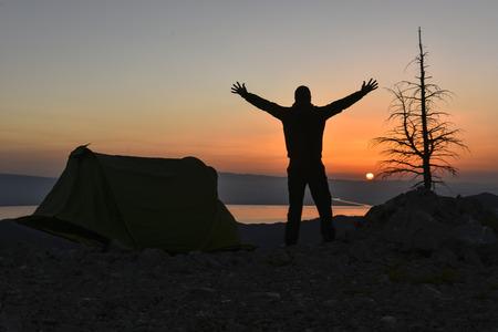 winning mood: camp and sunrise at the summit Stock Photo