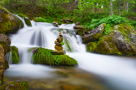 zen stones and clean waters of the waterfall