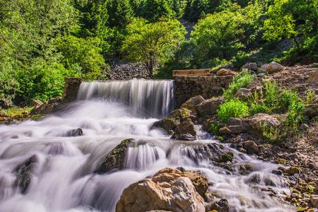 purl: source of flowing water, stream creek