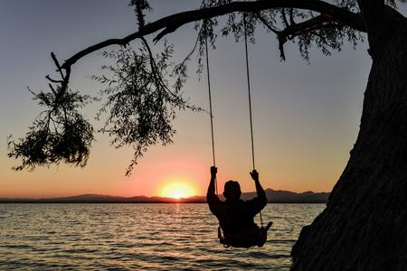 Swing and sunrise Stock Photo