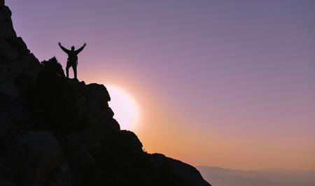 successful climbers on the summit sunrise Archivio Fotografico