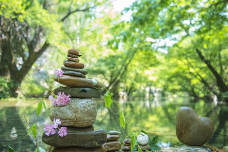 energy needs: zen stones at the waters edge Stock Photo