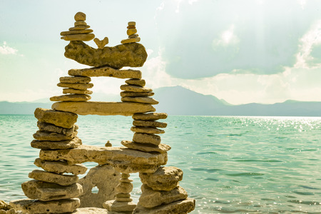 energy needs: zen stones, clouds and lake waters