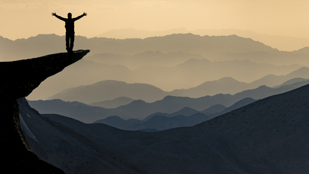 successful climbers on the summit of the mountain range Stock Photo