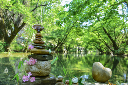 energy needs: zen stone and peace concept in river Stock Photo