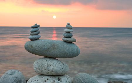 energy needs: stones and sea at sunrise