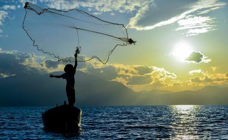 livelihoods: lake fisherman fishing net laying
