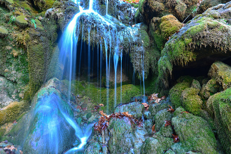 reddening: the waters of the waterfall and algae