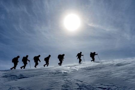 winter sun and climbers