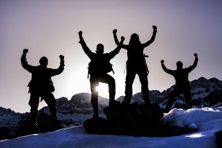 bravo: victory of the mountaineering team Stock Photo