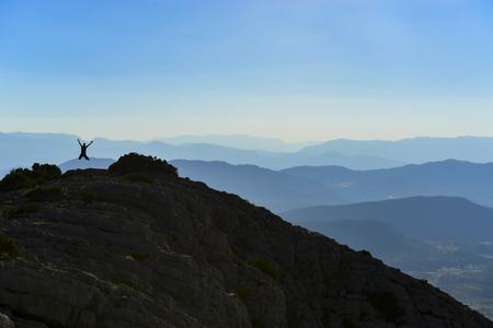 happy man on the summit of the mountain Stock fotó