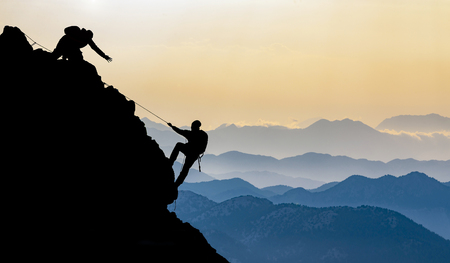 Mysterious exploration and ascent in the mountains & mountaineering Stock Photo