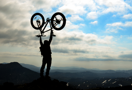 Mountain chains and summit rider success Stock Photo