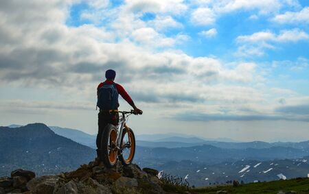 Mountain cyclist appreciating the view from the mountain Stock Photo