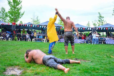 wrestlers: successful oil wrestling champion Stock Photo