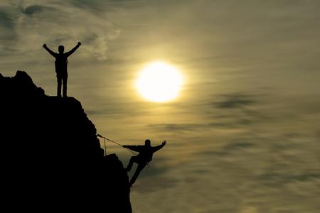 pessoas: escalada bem sucedida e fa Imagens
