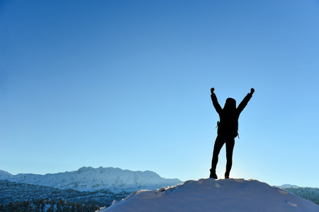 successful lady climber at the top of the mountains Stock Photo