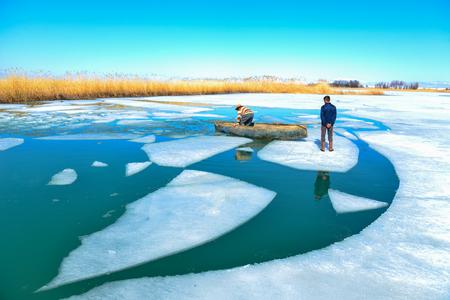 frozen lake fishing business Stock Photo