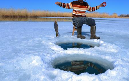 frozen lake and fishing struggle